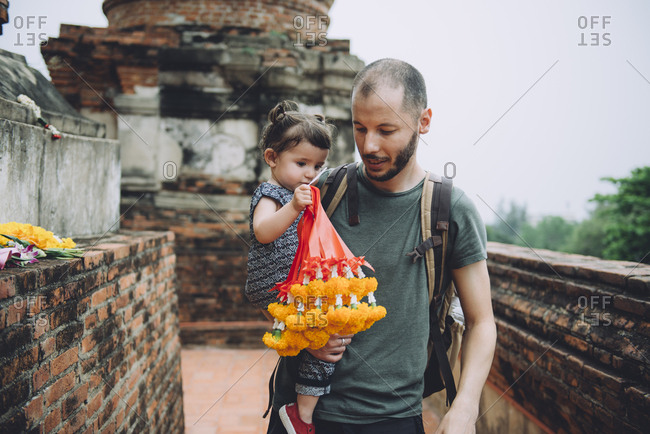 Thailand- Ayutthaya- father and little daughter bringing offerings at Wat Yai Chaya Mongkhon temple complex