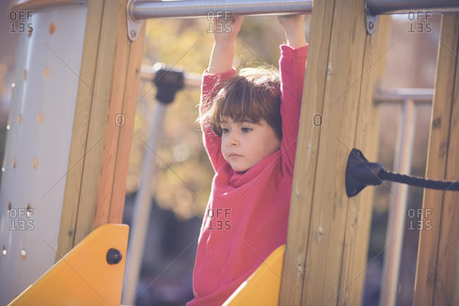 Portrait of pensive little girl on   playground