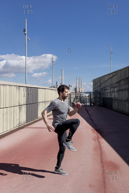 Sportive man exercising outdoors between walls