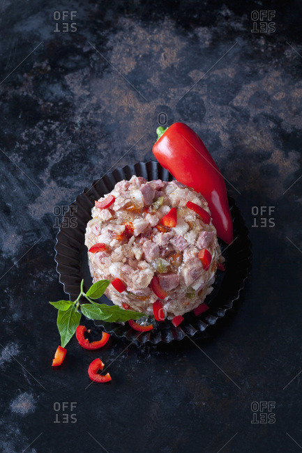 Pork in aspic with red bell pepper