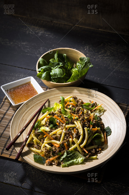 Asian mincemeat salad with macaroni- ginger- chili- garlic- carrot- spring onion- soy lemon sauce