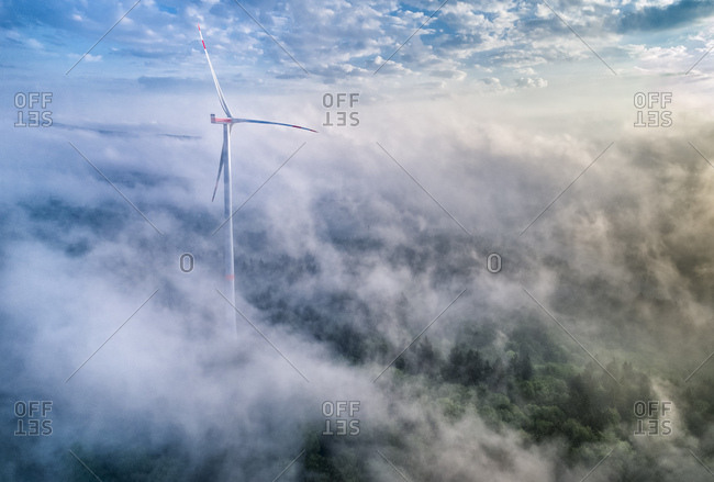 Germany- Baden-Wuerttemberg- Schurwald- Aerial view of wind wheel and morning fog