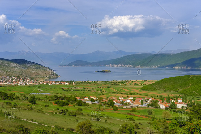 Albania- Prespa National Park- Lake Prespa with Maligrad Island and villages Lejthize and Liqenas- Greece and Macedonia in the background