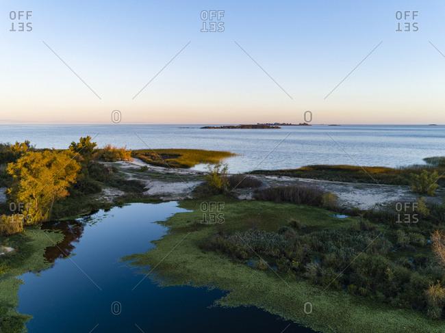 View over coastal wetlands out to the ocean in Colonia del Sacramento, Uruguay