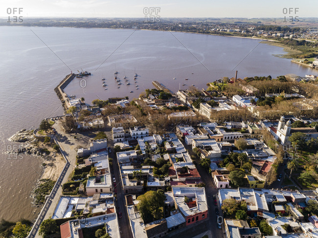 Drone's eye view over coastal part of town and small harbor in Colonia del Sacramento, Uruguay
