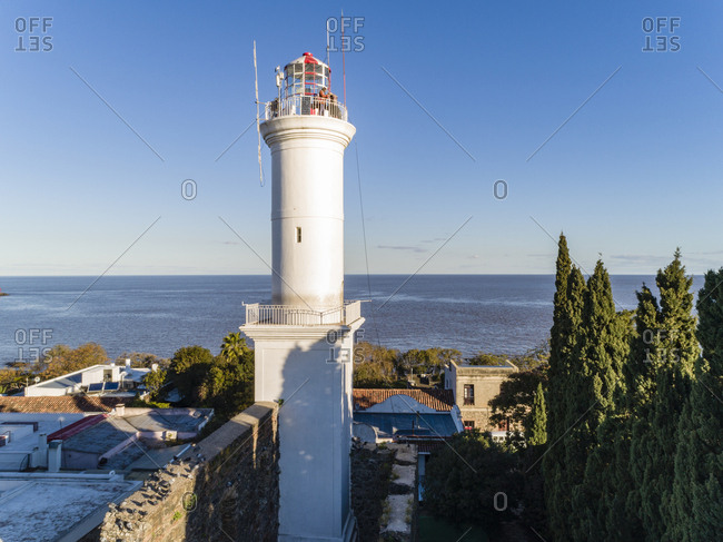 People standing on top of lighthouse on sunny fall afternoon in Colonia del Sacramento, Uruguay
