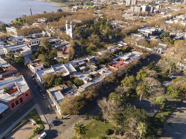 Aerial view over low rise neighborhood and church in Colonia del Sacramento, Uruguay