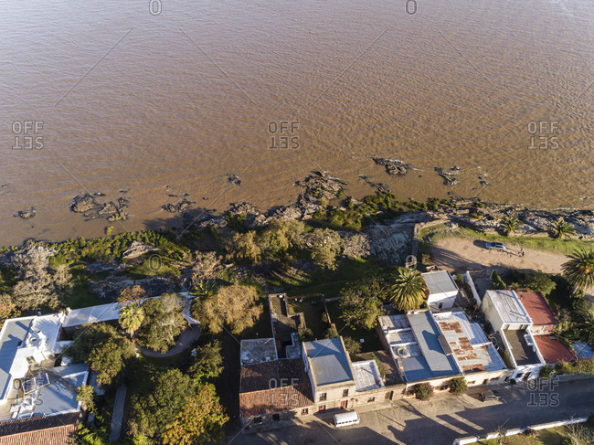 Drone's eye view of rocky shoreline of River Plate at Colonia del Sacramento, Uruguay