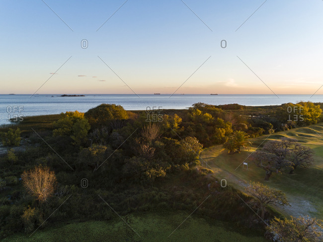 Aerial view over golf course at ships in distance on River Plate in Colonia del Sacramento, Uruguay