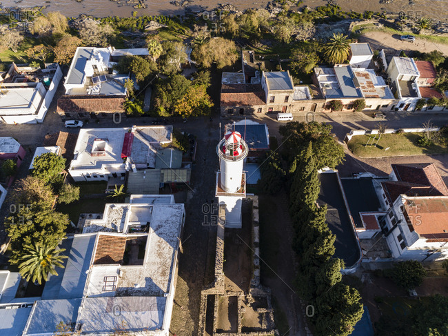 Drone shot of lighthouse and neighboring houses in Colonia del Sacramento, Uruguay