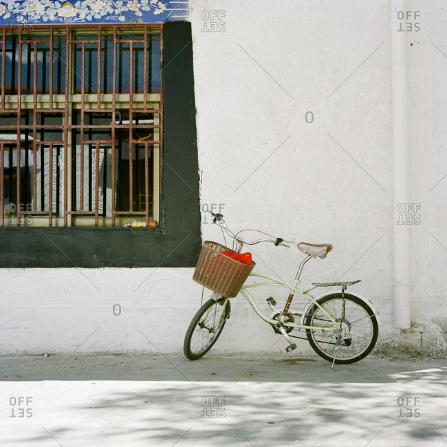 Bicycle leaning against an old building in Lhasa, Tibet