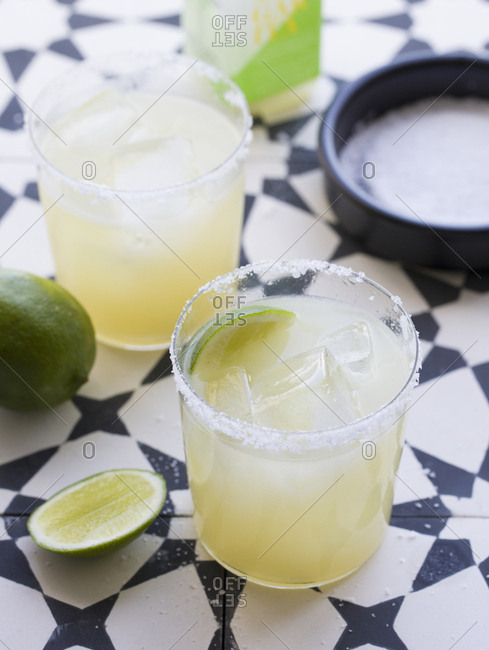 Two margaritas served with lime