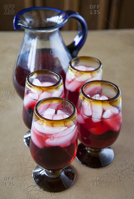 Sorrel cocktail with ice served in glasses with pitcher