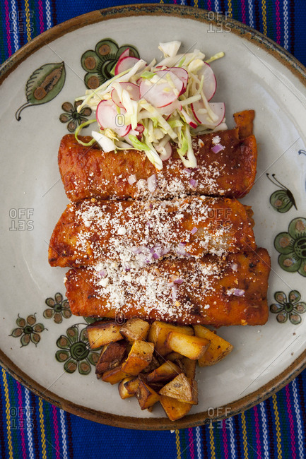 Homemade enchiladas with potatos and cole slaw