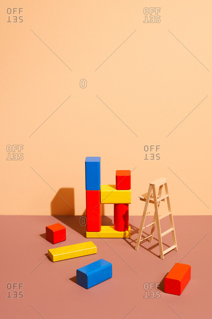 Colorful wooden blocks on pastel background