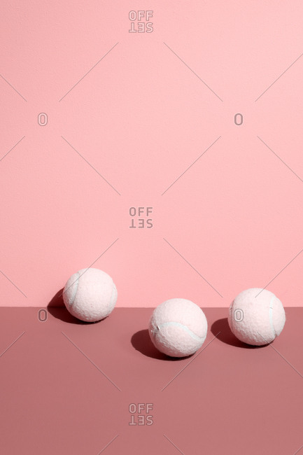 Tennis balls on pastel background