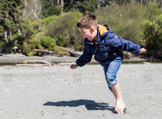 Boy laughing on the sand, Ruby Beach, Washington