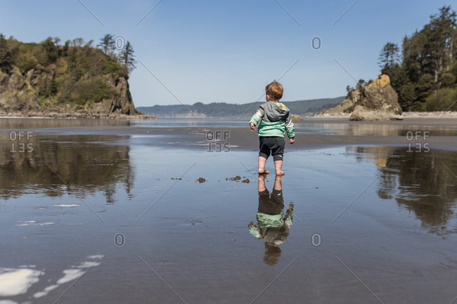 Toddler stands on Ruby Beach, Washington