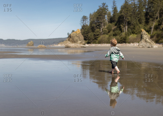 Toddler strolls on Ruby Beach, Washington
