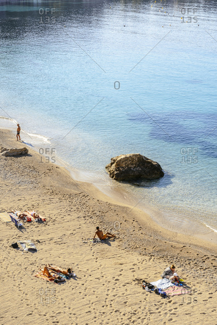 Villefranche, France - June 22, 2016: People relaxing on a sandy beach