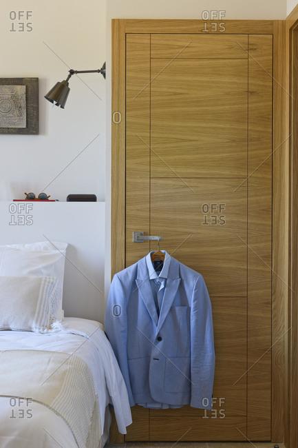 Ramatuelle, France - September 5, 2015: Jacket hanging on handle of closet inside house
