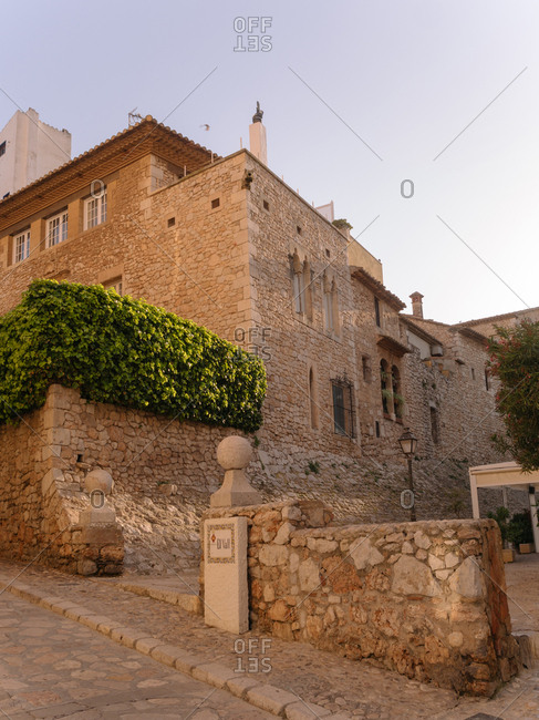 Courtyard view of rustic building exterior in the afternoon