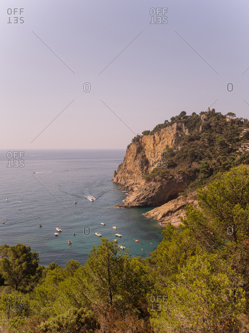 High angle view from coastal cliffside of boats at sea