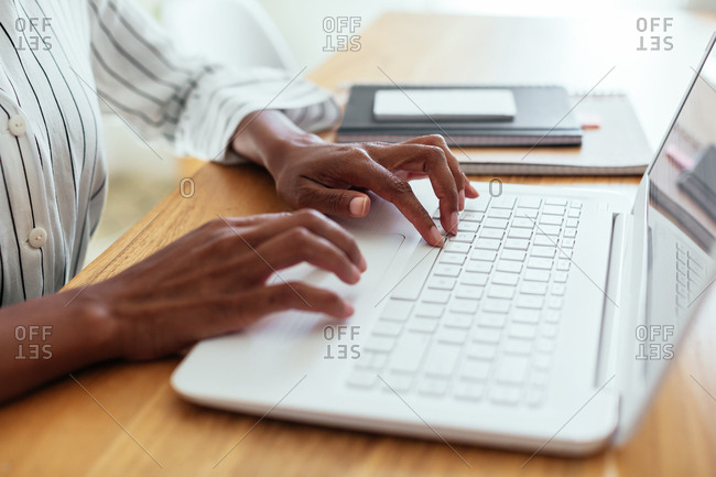 Anonymous woman typing on laptop