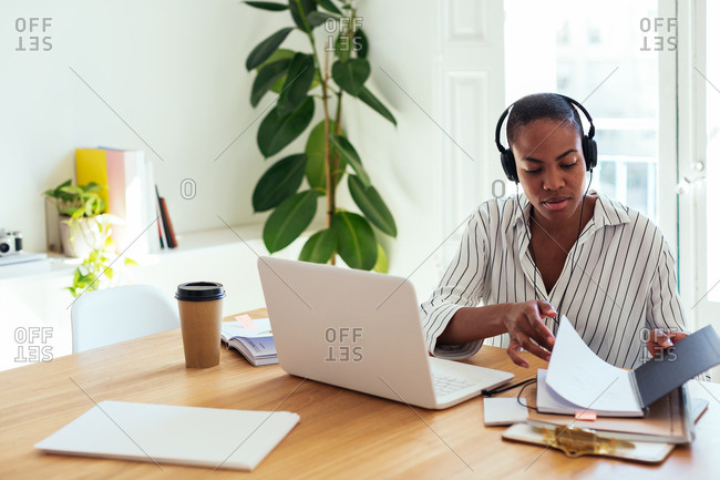 Woman with headphone working in office