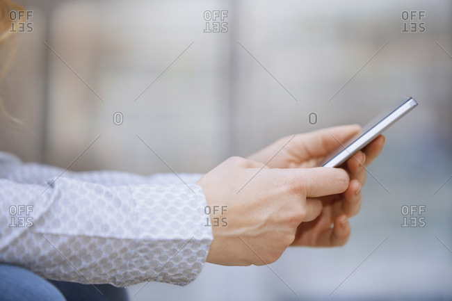 Businesswoman using smartphone at office