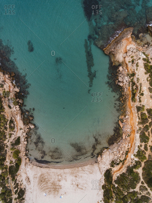 Drone view of scenic lagoon and rocky beach in Spain