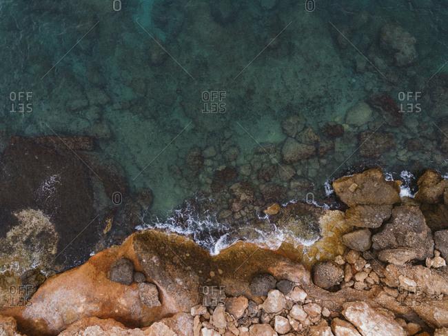 Top view closeup of shallow Spanish beachside