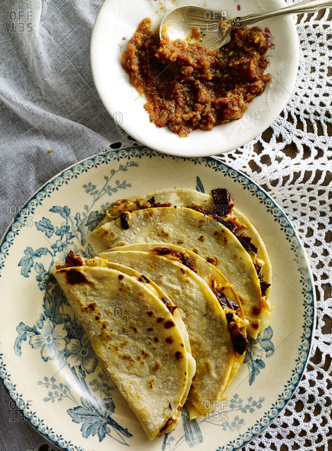 Chile ancho quesadillas served with a side of salsa