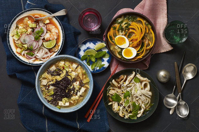 Four bowls of different Asian style soups