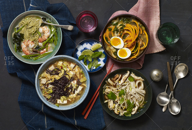 Four bowls of Asian style soups
