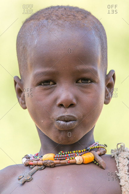 Ethiopia - November, 25, 2014: Close-up view of lovely black toddler smiling and looking at camera