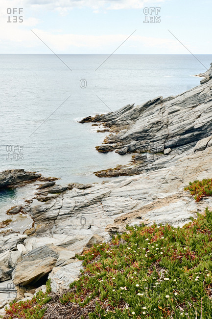 Secluded rocky beach along Cadaques shore