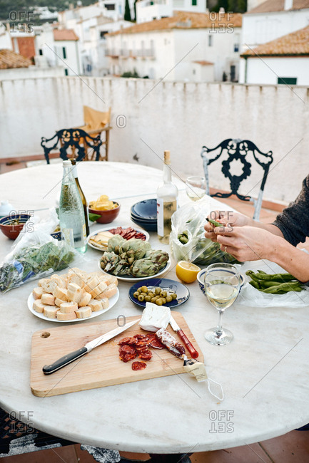 Cadaques, Spain - May 11, 2018: Person eating tapas dinner on outdoor patio