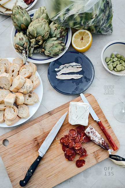 Cadaques, Spain - May 11, 2018: Top view of tapas ingredients in kitchen