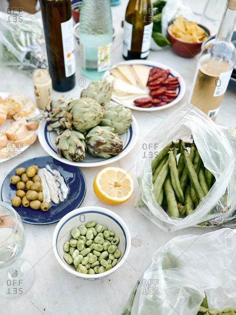 Dinner sides and wine bottles served on table