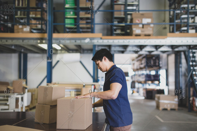 Male working in packing warehouse
