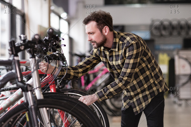Adult male choosing a bike in a cycle store