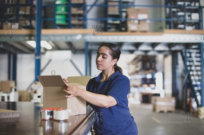 Female working in packing warehouse
