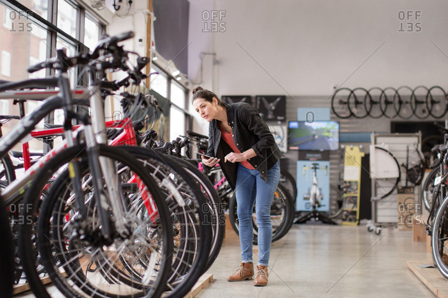 Small business owner stock taking in a bike store