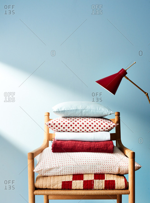 Linens Stacked on Chair