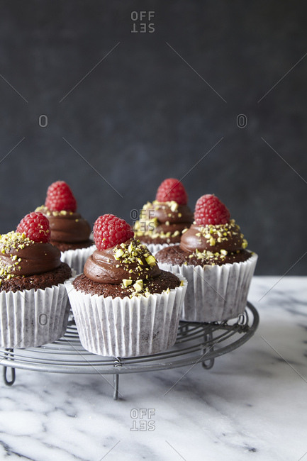 Chocolate Cupcakes with chocolate ganache and raspberries