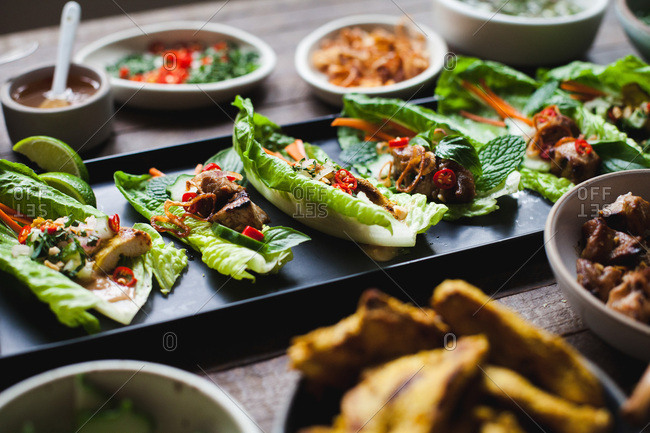 Thai lettuce cups on wood background
