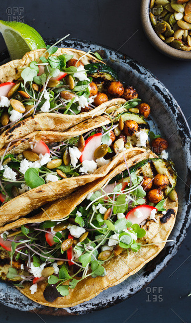 Vegetable tacos on blue background