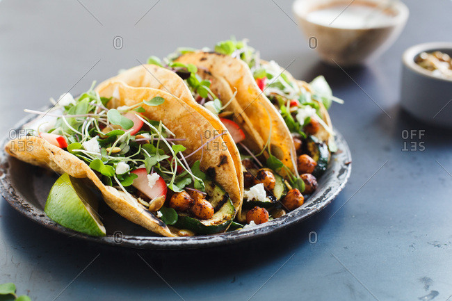 Vegetable tacos on blue background