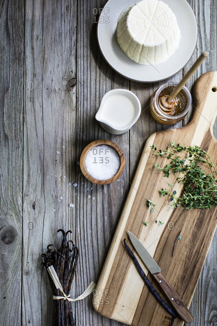 Ingredients for cooking alongside a wooden chopping board